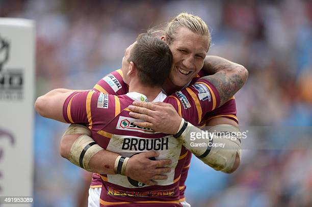 Danny Brough of Huddersfield Giants celebrates with Eorl Crabtree after scoring a second half try during the Super League match between Huddersfield...
