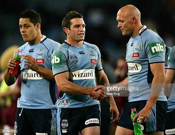 Danny Buderus shakes hands with Craig Fitzgibbon of the Blues after match three of the ARL State of Origin series between the New South Wales Blues...