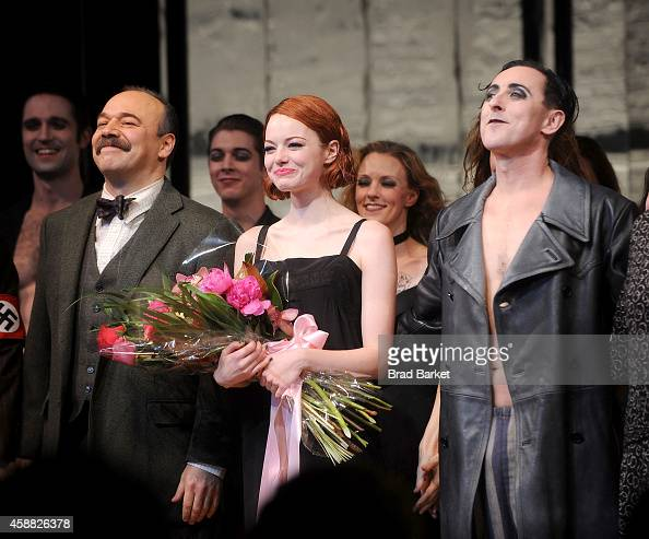 Danny Burstein Emma Stone and Alan Cumming onstage during Emma Stone's debut performance in Broadway's 'Cabaret' at Roundabout Theatre Company's...