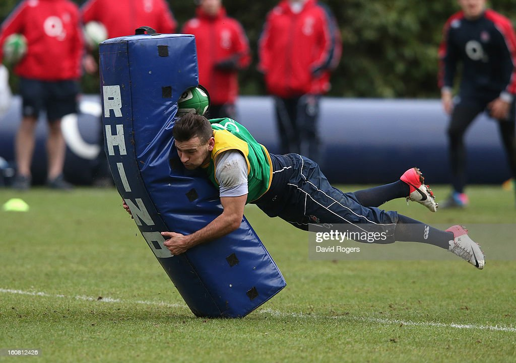 <a gi-track='captionPersonalityLinkClicked' href=/galleries/search?phrase=Danny+Care&family=editorial&specificpeople=539686 ng-click='$event.stopPropagation()'>Danny Care</a> dives onto a tackle bag during the England training session held at Pennyhill Park on February 6, 2013 in Bagshot, England.