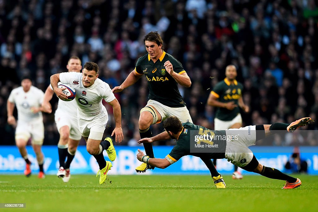 <a gi-track='captionPersonalityLinkClicked' href=/galleries/search?phrase=Danny+Care&family=editorial&specificpeople=539686 ng-click='$event.stopPropagation()'>Danny Care</a> of England breaks clear from the tackle of <a gi-track='captionPersonalityLinkClicked' href=/galleries/search?phrase=Willie+Le+Roux&family=editorial&specificpeople=9029846 ng-click='$event.stopPropagation()'>Willie Le Roux</a> of South Africa during the QBE Intenational match between England and South Africa at Twickenham Stadium on November 15, 2014 in London, England.