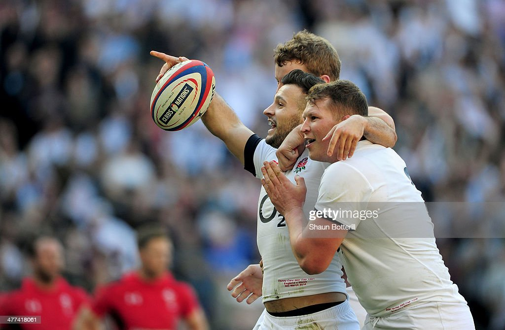 Danny Care of England (C) celebrates with Joe Launchbury (L) and Dylan Hartley (R) as he scores their first try during the RBS Six Nations match between England and Wales at Twickenham Stadium on March 9, 2014 in London, England.
