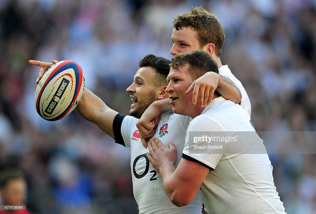 Danny Care of England (L) celebrates with Joe Launchbury (C) and Dylan Hartley (R) as he scores their first try during the RBS Six Nations match between England and Wales at Twickenham Stadium on March 9, 2014 in London, England.