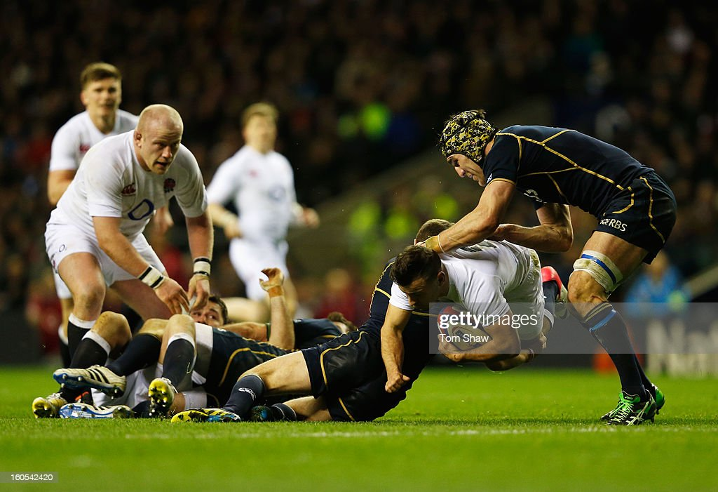 Danny Care of England is blocked by Kelly Brown of Scotland (R) during the RBS Six Nations match between England and Scotland at Twickenham Stadium on February 2, 2013 in London, England.