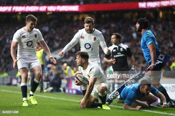 Danny Care of England is congratulated by teammates Elliott Daly and Owen Farrell after scoring his team's second try during the RBS Six Nations...