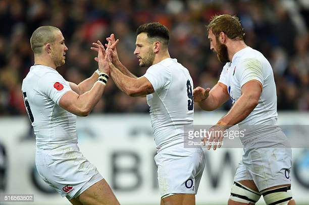 Danny Care of England is congratulated by teammates Mike Brown and Chris Robshaw after scoring the opening try during the RBS Six Nations match...