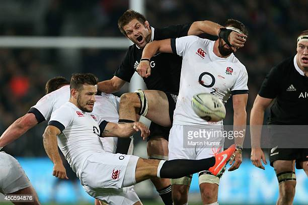 Danny Care of England kicks during the International Test Match between the New Zealand All Blacks and England at Forsyth Barr Stadium on June 14...