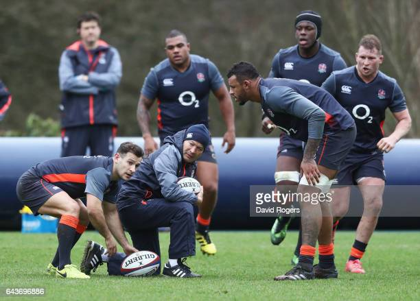 Danny Care of England looks to pass with coach Eddie Jones during an England training session at Pennyhill Park on February 22 2017 in Bagshot England
