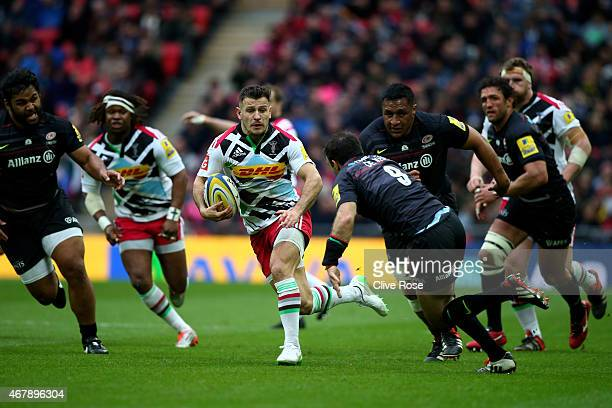 Danny Care of Harlequins breaks through the tackle from Neil de Kock of Saracens during the Aviva Premiership match between Saracens and Harlequins...