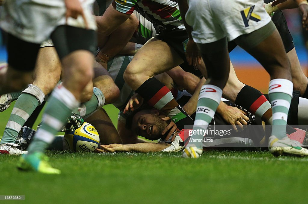 <a gi-track='captionPersonalityLinkClicked' href=/galleries/search?phrase=Danny+Care&family=editorial&specificpeople=539686 ng-click='$event.stopPropagation()'>Danny Care</a> of Harlequins goes over to score the opening try during the Aviva Premiership match between Harlequins and London Irish at Twickenham Stadium on December 29, 2012 in London, England.