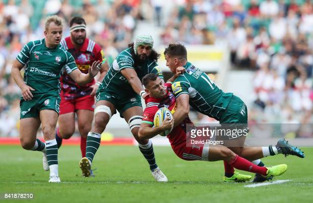 Danny Care of Harlequins is tackled by Alex Lewington and Blair Cowan of London Irish during the Aviva Premiership match between London Irish and...