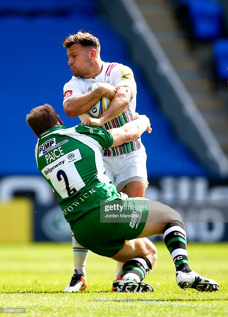 <a gi-track='captionPersonalityLinkClicked' href=/galleries/search?phrase=Danny+Care&family=editorial&specificpeople=539686 ng-click='$event.stopPropagation()'>Danny Care</a> of Harlequins is tackled by David Paice of London Irish during the Aviva Premiership match between London Irish and Harlequins at the Madejski Stadium on May 01, 2016 in Reading, England.