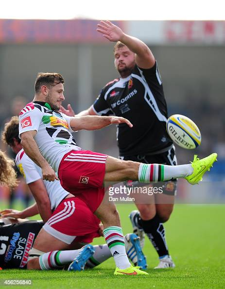Danny Care of Harlequins kicks under pressure from Tomas Francis of Exeter Chiefs during the Aviva Premiership match between Exeter Chiefs and...