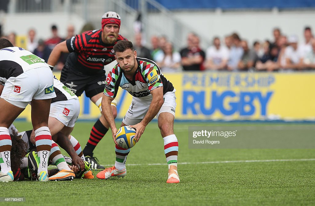<a gi-track='captionPersonalityLinkClicked' href=/galleries/search?phrase=Danny+Care&family=editorial&specificpeople=539686 ng-click='$event.stopPropagation()'>Danny Care</a> of Harlequins passes the ball during the Aviva Premiership semi final match between Saracens and Harlequins at Allianz Park on May 17, 2014 in Barnet, England.