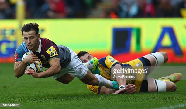 Danny Care of Harlequins scores the opening try during the Aviva Premiership match between Harlequins and Worcester Warriors at Twickenham Stoop on...