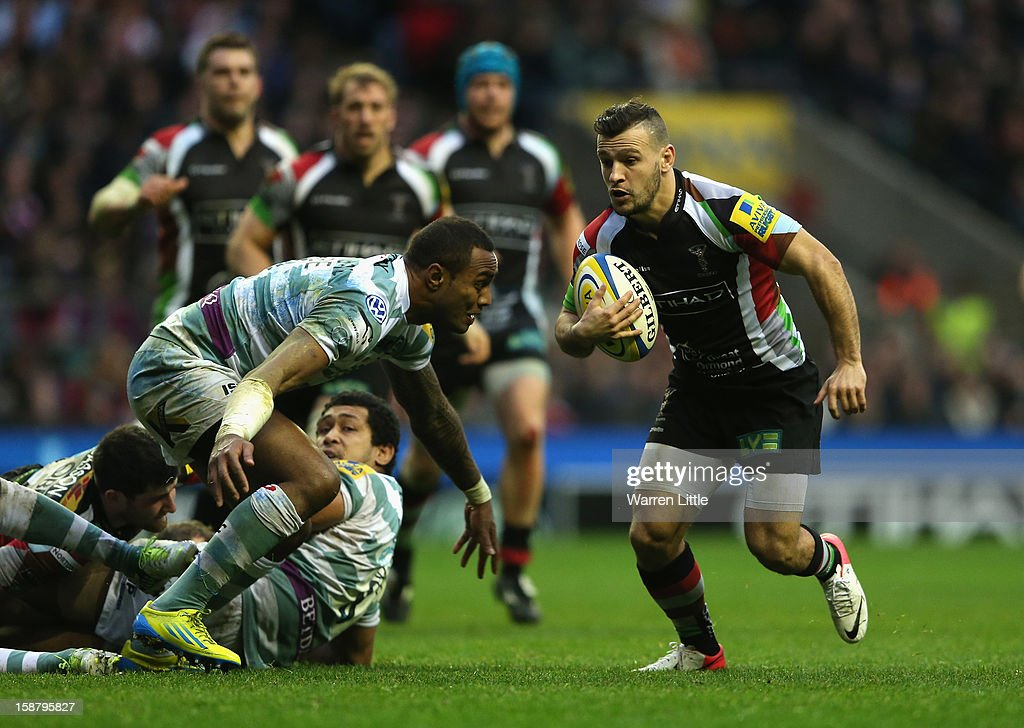 Danny Care of Harlequins takes on Sailosi Tagicakibau of London Irish before going over to score the opening try during the Aviva Premiership match between Harlequins and London Irish at Twickenham Stadium on December 29, 2012 in London, England.