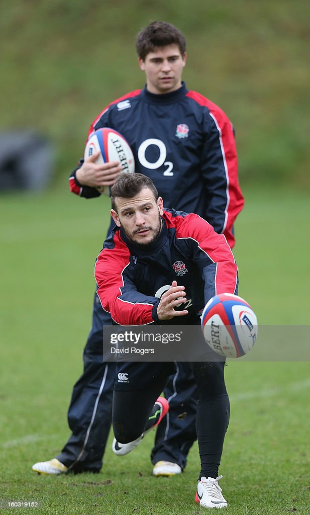 Danny Care passes the ball watched by Ben Youngs during the England training session at Pennyhill Park on January 29, 2013 in Bagshot, England.