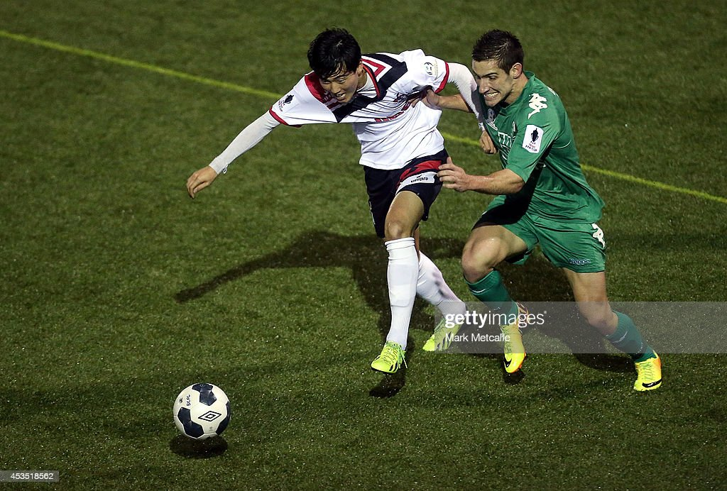 Danny Choi of Blacktown City and Jamie Deabreu of Bentleigh Greens compete for the ball during the FFA Cup match between Blacktown City and Bentleigh Greens at Lilys Football Centre on August 12, 2014 in Blacktown, Australia.