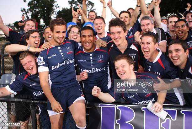 Danny Cipriani and Cooper Vuna of the Rebels celebrate with their supporters after the Super Rugby trial match between the Melbourne Rebels and Tonga...