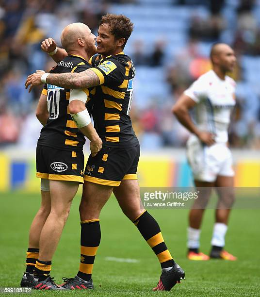 Danny Cipriani and Joe Simpson of Wasps celebrate victory during the Aviva Premiership match between Wasps and Exeter Chiefs at Ricoh Arena on...
