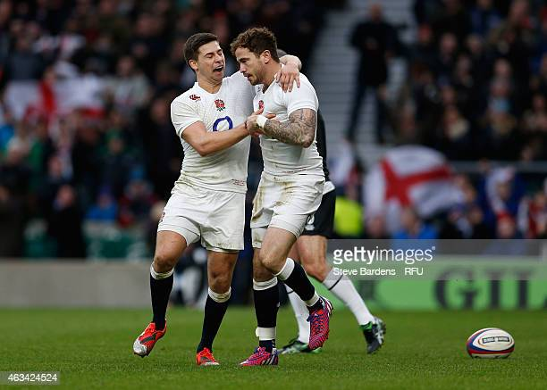 Danny Cipriani of England is congratulated by Ben Youngs after scoring his try during the RBS Six Nations match between England and Italy at...