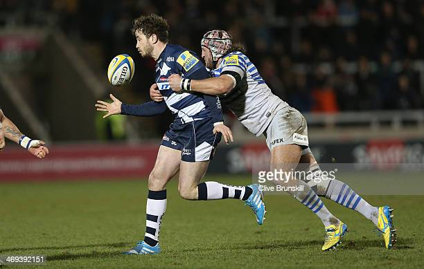Danny Cipriani of Sale attempts to move away from Jacques Burger of Saracens during the Aviva Premiership match between Sale Sharks and Saracens at...