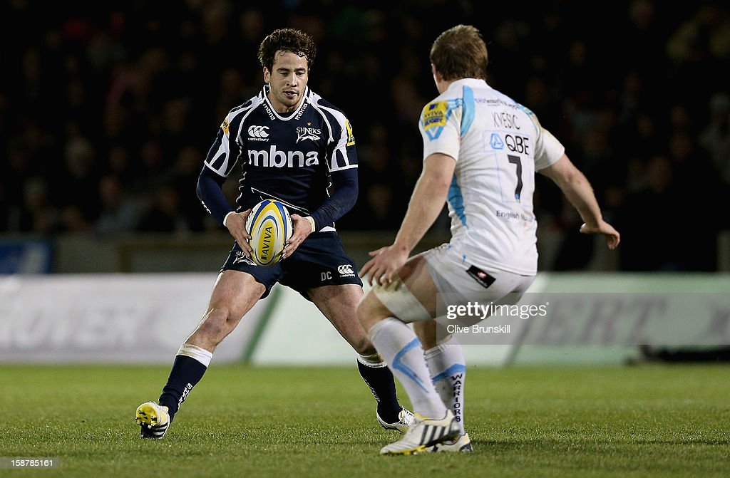 <a gi-track='captionPersonalityLinkClicked' href=/galleries/search?phrase=Danny+Cipriani&family=editorial&specificpeople=688774 ng-click='$event.stopPropagation()'>Danny Cipriani</a> of Sale Sharks attempts to move past Matt Kvesic of Worcester Warriors during the Aviva Premiership match between Sale Sharks and Worcester Warriors at Salford City Stadium on December 28, 2012 in Salford, England.