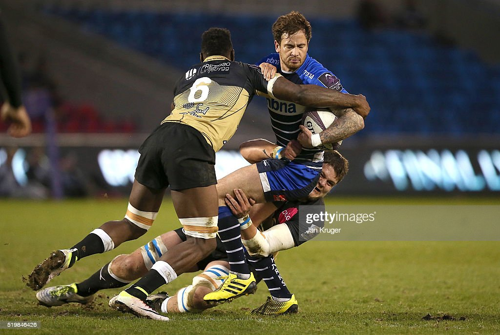 Danny Cipriani of Sale Sharks is tackled by Fulgence Ouedraogo of Montpellier during the European Rugby Challenge Cup Quarter Final match between...