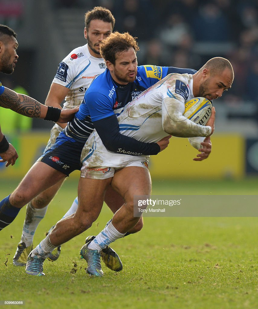 <a gi-track='captionPersonalityLinkClicked' href=/galleries/search?phrase=Danny+Cipriani&family=editorial&specificpeople=688774 ng-click='$event.stopPropagation()'>Danny Cipriani</a> of Sale Sharks tackles Olly Woodburn of Exeter Chiefs during the Aviva Premiership match between Sale Sharks and Exeter Chiefs at the A J Bell Stadium on February 13, 2016 in Salford, England