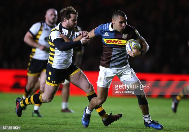 Danny Cipriani of Wasps pulls back Joe Marchant of Harlequins during the Aviva Premiership match between Harlequins and Wasps at Twickenham Stoop on...