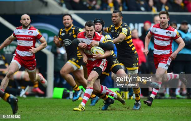 Danny Cipriani of Wasps tackles Tom Marshall of Gloucester Rugby during the Aviva Premiership match between Wasps and Gloucester Rugby at The Ricoh...