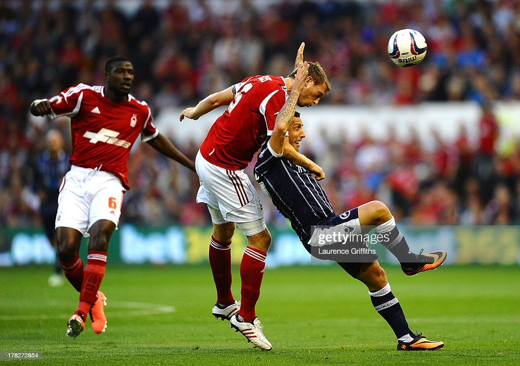 Danny Collins of Nottingham Forest battles with Scott McDonald of Millwall during the Capital One Cup Second Round match between Nottingham Forest...
