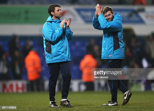 Danny Cowley manager of Lincoln City and his brother and Assistant manager Nicky Cowley applaud supporters during the Emirates FA Cup third round...