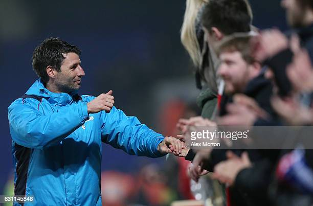 Danny Cowley manager of Lincoln City celebrates with supporters during the Emirates FA Cup third round match between Ipswich Town and Lincoln City at...