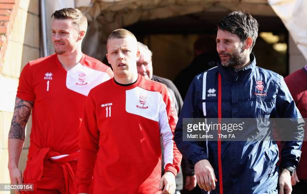 Danny Cowley manager of Lincoln City walks onto the pitch with his players during a Lincoln City Media Day ahead of their FA Cup match against...