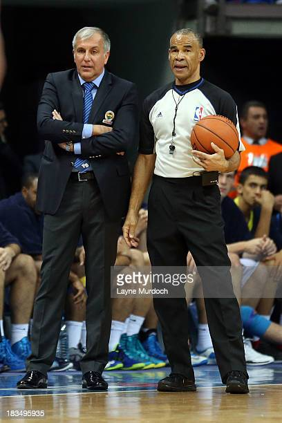 Danny Crawford NBA official talks with Zeljko Obradovic head coach of the Fenerbahce Ulker as part of the NBA Global Games on October 5 2013 at the...
