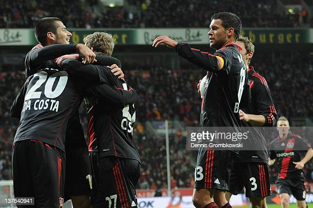 Danny da Costa of Leverkusen celebrates with teammates after Niko Bongert of Mainz has scored Leverkusen's opening goal during the Bundesliga match...