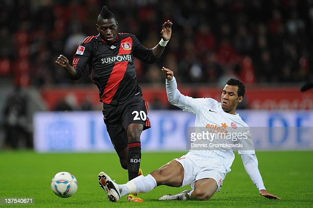 Danny da Costa of Leverkusen is challenged by Eric Maxim ChoupoMoting of Mainz during the Bundesliga match between Bayer 04 Leverkusen and FSV Mainz...