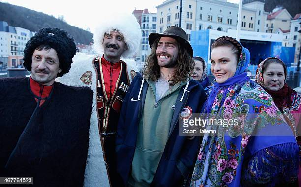 Danny Davis of the USA Snowboarding team poses with local residents in the Rosa Khutor Mountain Village ahead of the Sochi 2014 Winter Olympics on...