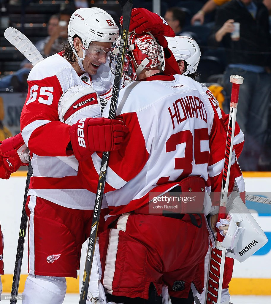 Danny DeKeyser #65 congratulates <a gi-track='captionPersonalityLinkClicked' href=/galleries/search?phrase=Jimmy+Howard&family=editorial&specificpeople=2118637 ng-click='$event.stopPropagation()'>Jimmy Howard</a> #35 of the Detroit Red Wings after defeating the Nashville Predators during an NHL game at the Bridgestone Arena on April 14, 2013 in Nashville, Tennessee.