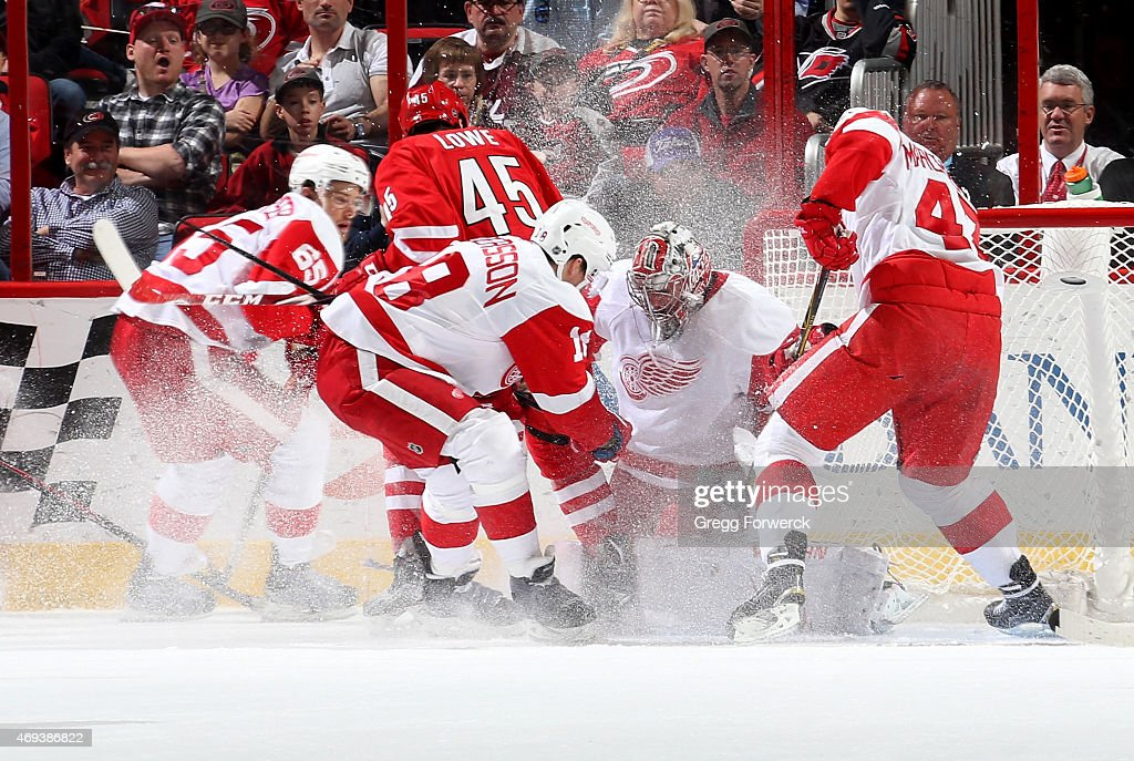 Danny DeKeyser Joakim Andersson and Alexey Marchenko of the Detroit Red Wings help teammate Petr Mrazek defend the net as Keegan Lowe of the Carolina...