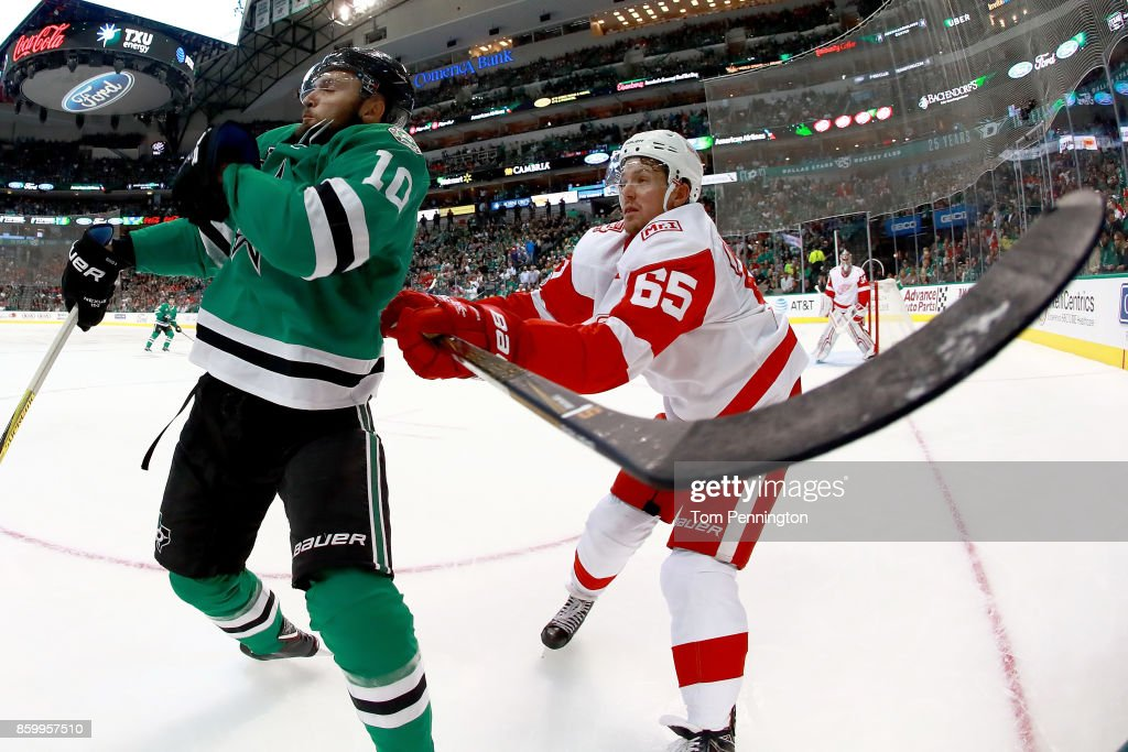 Danny DeKeyser #65 of the Detroit Red Wings checks Martin Hanzal #10 of the Dallas Stars in the first period at American Airlines Center on October 10, 2017 in Dallas, Texas.