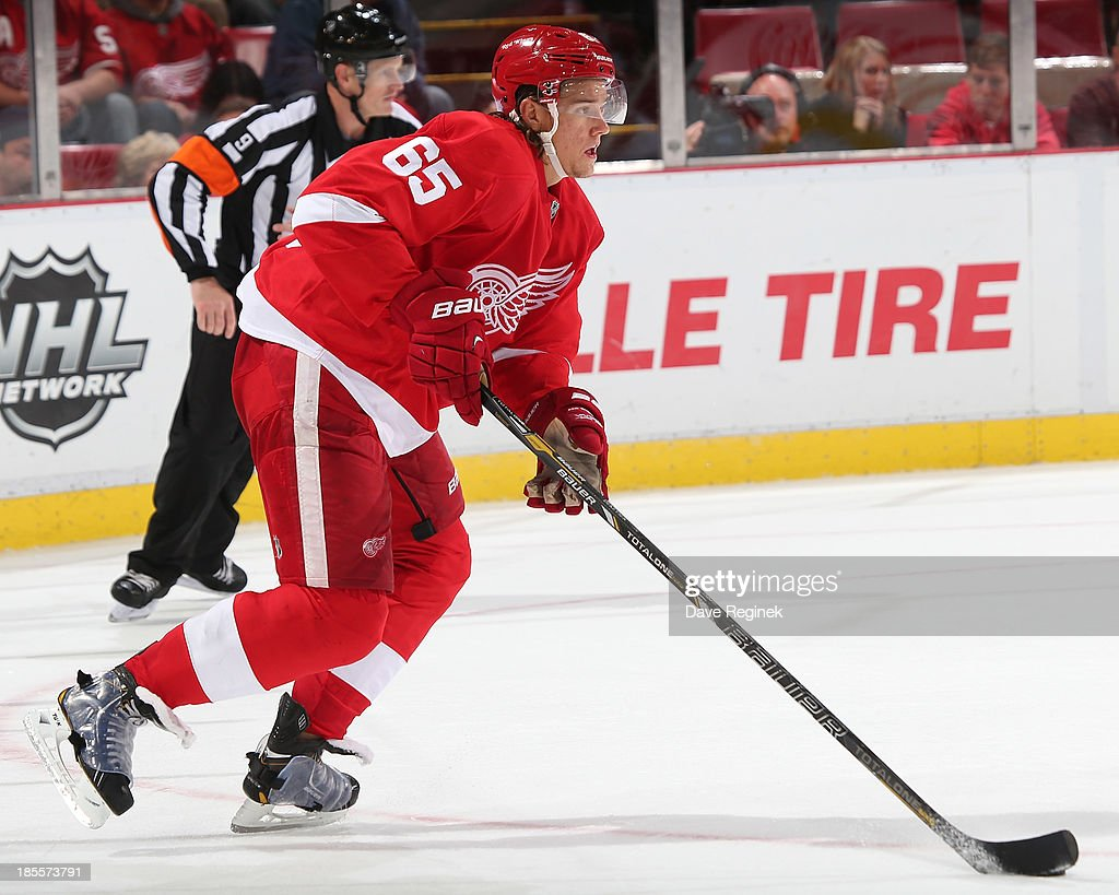 Danny DeKeyser #65 of the Detroit Red Wings controls the puck during an NHL game against the San Jose Sharks at Joe Louis Arena on October 21, 2013 in Detroit, Michigan. San Jose Sharks won in a shoot-out 1-0.