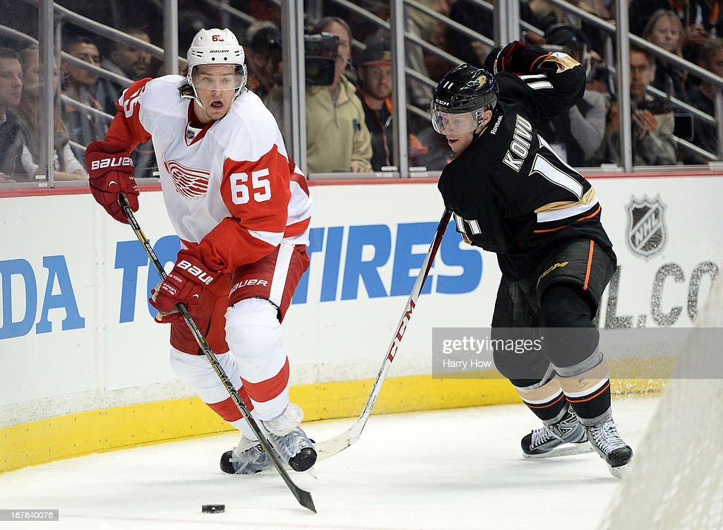Danny DeKeyser #65 of the Detroit Red Wings eludes Saku Koivu #11 of the Anaheim Ducks in Game One of the Western Conference Quarterfinals during the 2013 Stanley Cup Playoffs at Honda Center on April 30, 2013 in Anaheim, California. The Ducks won 3-1.