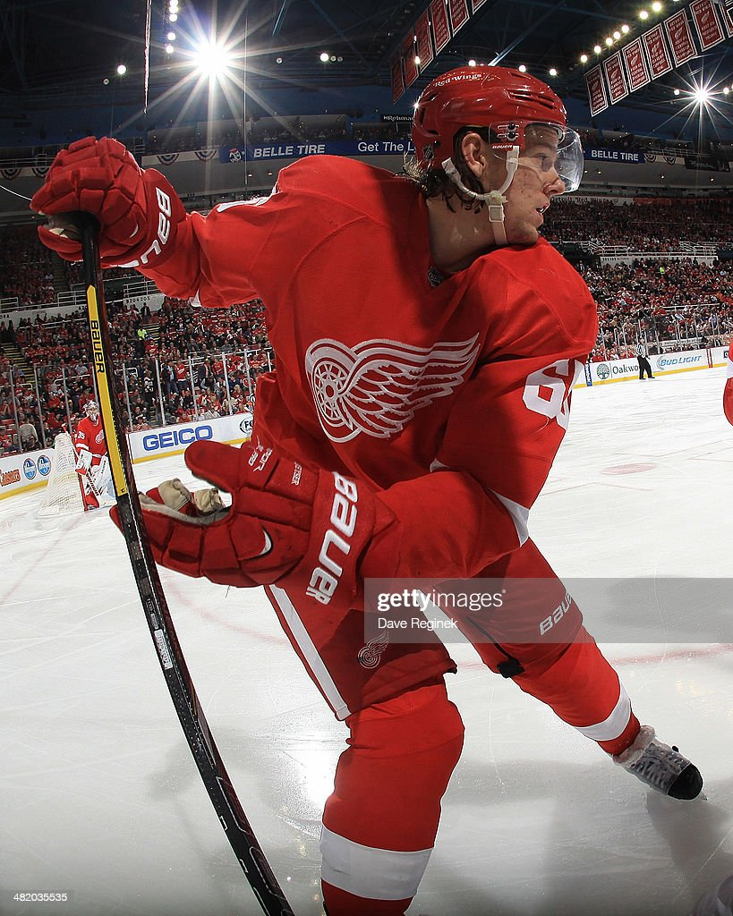 Danny DeKeyser #65 of the Detroit Red Wings follows the play against the Montreal Canadiens during an NHL game on March 27, 2014 at Joe Louis Arena in Detroit, Michigan. Montreal defeated Detroit 5-4