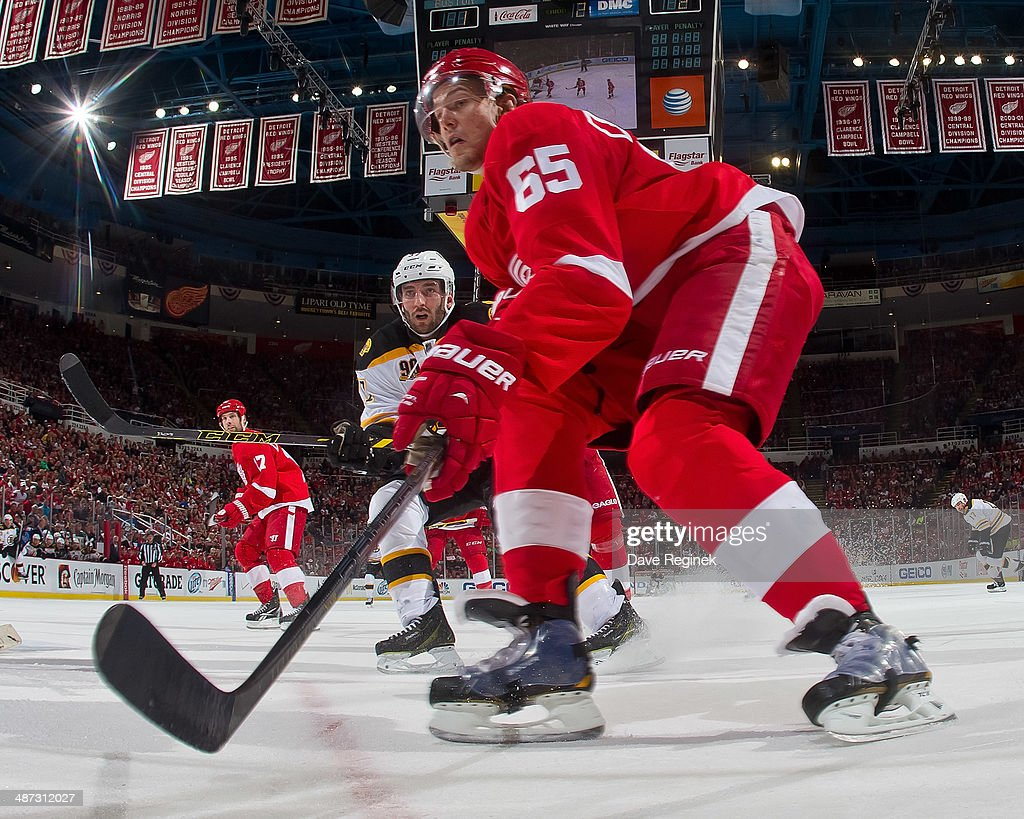 Danny DeKeyser #65 of the Detroit Red Wings follows the play against the Boston Bruins during Game Four of the First Round of the 2014 Stanley Cup Playoffs on April 24, 2014 at Joe Louis Arena in Detroit, Michigan. Bruins defeated Detroit 3-2 in OT
