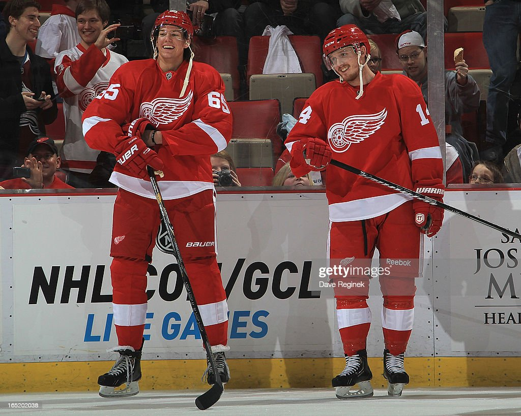 Danny DeKeyser #65 of the Detroit Red Wings has a laugh with teammate Gustav Nyquist #14 in warm-ups before an NHL game against the Colorado Avalanche at Joe Louis Arena on April 1, 2013 in Detroit, Michigan.