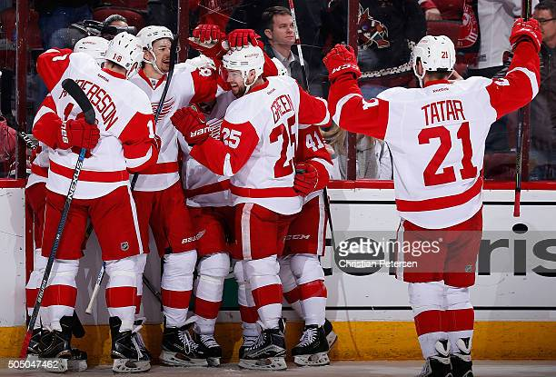 Danny DeKeyser of the Detroit Red Wings is congratulated by Joakim Andersson Mike Green Luke Glendening and Tomas Tatar after scoring the game...