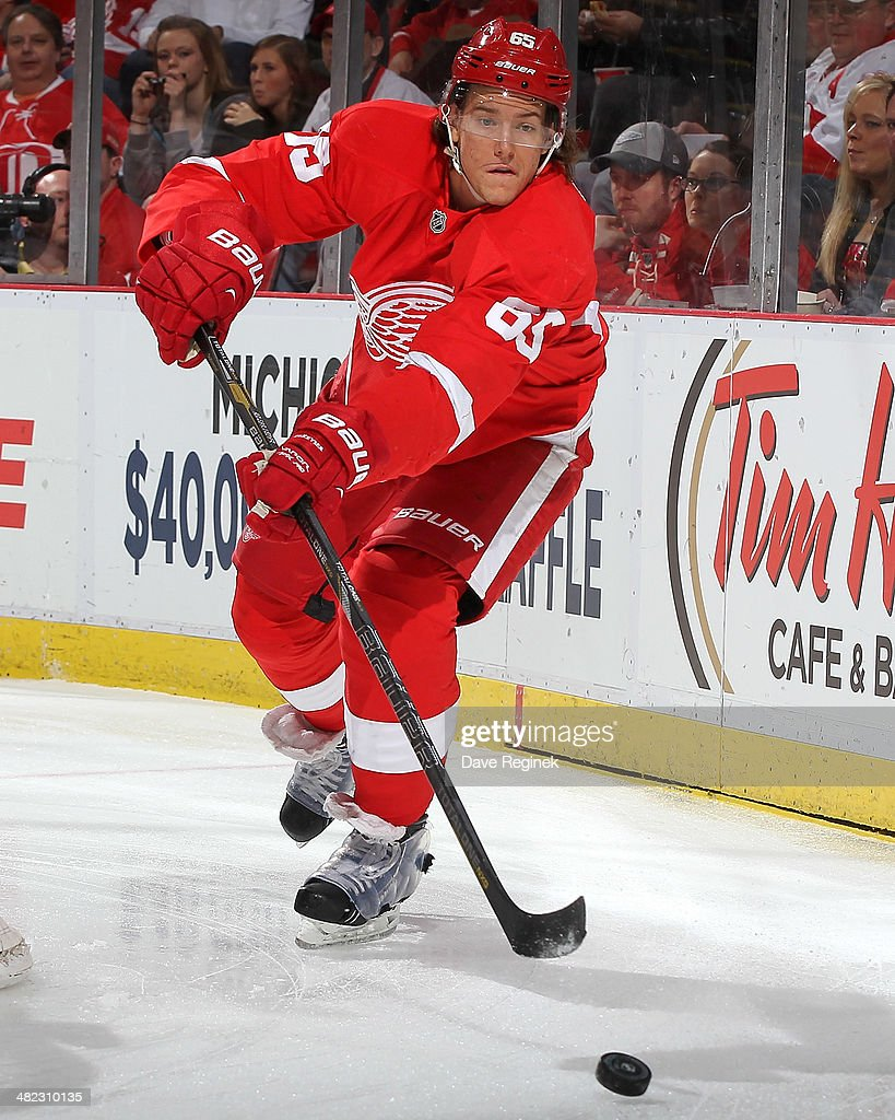 Danny DeKeyser #65 of the Detroit Red Wings passes the puck against the Tampa Bay Lightning during an NHL game on March 30, 2014 at Joe Louis Arena in Detroit, Michigan. Detroit defeated Tampa Bay 3-2