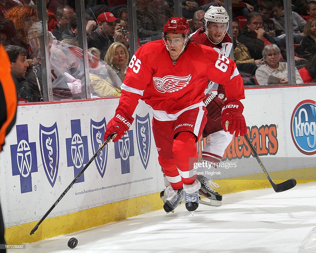 Danny Dekeyser #65 of the Detroit Red Wings reaches for the puck as <a gi-track='captionPersonalityLinkClicked' href=/galleries/search?phrase=Shane+Doan&family=editorial&specificpeople=201614 ng-click='$event.stopPropagation()'>Shane Doan</a> #19 of the Phoenix Coyotes skates behind him during a NHL game at Joe Louis Arena on April 22, 2013 in Detroit, Michigan.